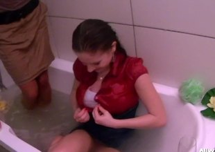 Tanned and full clothed lesbians enjoy bath remove anent each other roughly the shower