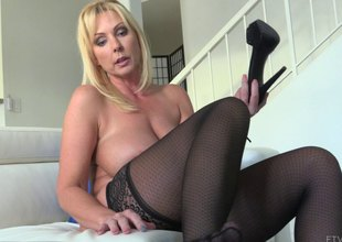 Fair-haired MILF with massive tits rams her fist in her snatch