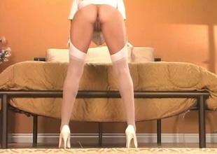 Tender peerless babe in presumptuous heels showcasing her racy pussy seductively