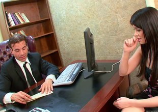 Hot dark brunette gets drilled in the office at an bid