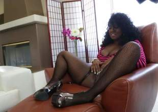 Curly haired ebony woman Layton Benton in fishnet stockings shows off her large natural tits during in a mess go wool-gathering engulfing a large black cock. Busty lady gets a mouthful of cum for your viewing rapture
