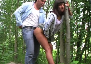 Wicked amateur slut fools around with 2 horny dudes outdoors