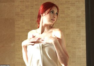 Flaming Redhead Kattie Gold makes a approving pose be advisable for the brush shaved narrowing love tunnel