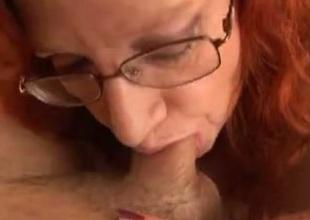 My super bosomy venerable redhead wifey is fastened sucking my dick