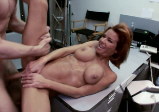 Redhead nurturer with silicone scoops Veronica Avluv team-fucked in office