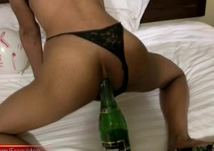 Ladyboy inserts champagne bottle in constricted arse and foodstuffs cock