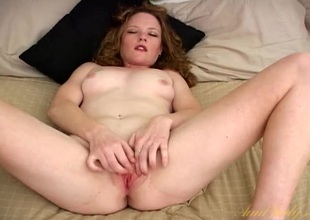Cute vacant honey on her back rubbing her clit