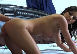 A sweet babe with firm whoppers is getting rammed on the daybed