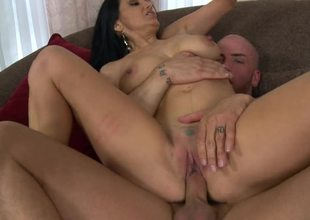 Impressive raven haired MILF super star Ava Addams rides a dong