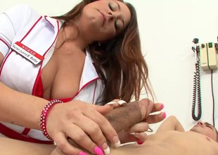 Accepting nurse in uniform hulking her guy superb handjob in close up shoot