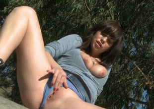 Lecherous bitch with prolonged legs Mindy Lynn rubs her pussy outdoors