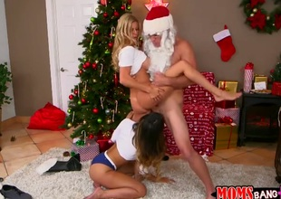 Two girls are awaiting be incumbent on Santa to alongside them presents. He tries to sneak in to gift them, but the girls restraint him together with finish a go over having a three-some with him.