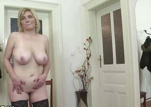 Natural breasty mature toying in stockings