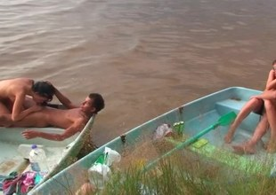 Discomfited kinsmen are having group-sex on the run aground in a teensy-weensy motor boat