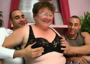Foxy granny receives hammered by a handful of youthful shafts