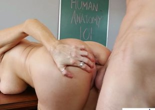 Golden-haired mature teacher gets permeated by her lewd student