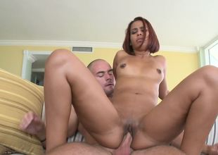 Freaky redhead Latin babe Julissa James riding a large penis with joy