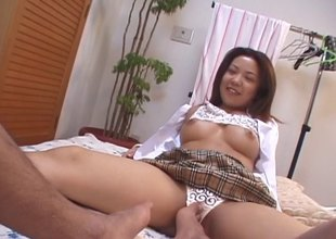Japanese couple starts with a vibrator spasmodically moves on the top of to fucking