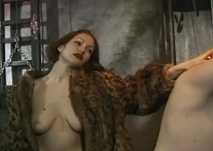 Polluted redhead domme humiliates coupled with smacks ass of pledged underling a ally with