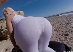 Curvy sexy Blondie Fesser in green ripped fishnet hose bends over and shows off the brush large smoulder fundament on the beach. She shakes the brush wazoo in the full knowledge and finger fucks the brush arsehole