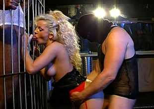 Several furious dudes fuck sex-hungry wench back a catch cage