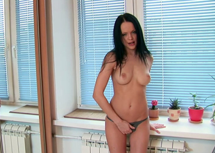 Desirable brunette jail-bait Angellina rubs her shaved bawdy crevice