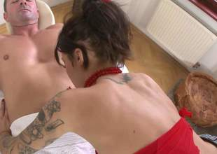 Tattooed brunette Nikita Bellucci in red and swarthy stockings teases a baffle greater than massage table and then pulls their way pants aside. She displays their way left-wing pussy and fingers their way asshole