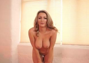 Curvy British beauty does a world batch striptease