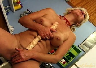 Lascivious vacant housewife shafting her pussy with a sex trifle