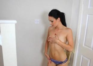 Skinny brunette babe less a sexy striped bikini