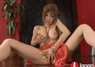 Japanese gal soaked in lube together with fucking a toy