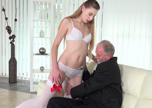 Grey businessman fucks a charming blonde escort on the sofa