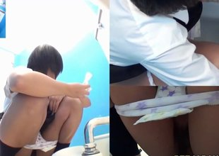 Teen Oriental schoolgirls taking a piss in the toilet