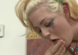 A kinky blonde thing is getting a ramrod in her mouth to suck on